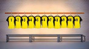 Rij van Gele Overhemden 1-11 van Voetbaloverhemden Stock Foto