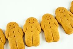 Rij van glimlachende peperkoekmensen Stock Foto