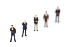 Rij van miniatuur bedrijfsmensen Royalty-vrije Stock Foto's