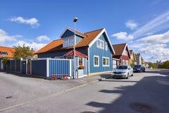 Rij van oude kleurrijke blokhuizen in de stad Royalty-vrije Stock Afbeeldingen