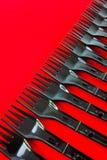 Rij van plastic vorken Stock Afbeelding