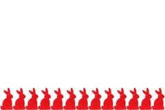 Rij van rode konijnen stock afbeelding