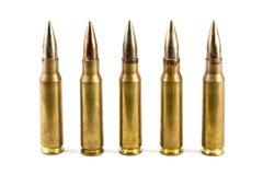 Rij van vijf geweerkogels Stock Foto