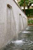 Rij van waterfonteinen stock foto's