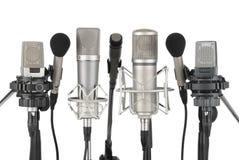 Rij van zeven microfoons Royalty-vrije Stock Foto