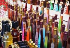 Rijeka, Chorwacja, Grudzień 29, 2018 Stubarwne szklane butelki z alkoholicznym ajerkoniakiem wystawiającym dla sprzedaży przy sto obraz stock
