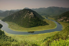 Rijeka Crnojevica. (Town of River of Crnojevici) is little town stopped the time. Located near Skadar Lake, Montenegro. Sinuous river flowing through mountains Royalty Free Stock Photography