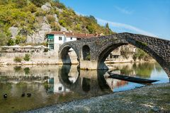 The old arched stone bridge of Rijeka Crnojevica, Montenegro Royalty Free Stock Photo