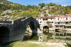 The old arched stone bridge of Rijeka Crnojevica, Montenegro Stock Images