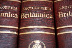 Rijeka, Croatia, September 25, 2018. Top view of volume encyclopedia Britannica with title. Close up view of red and gold cover royalty free stock images