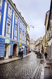 RIJEKA ,CROATIA -  typical small town main street in Croatia. RIJEKA ,CROATIA -  typical small town  main street in Croatia .blue antique building Stock Image