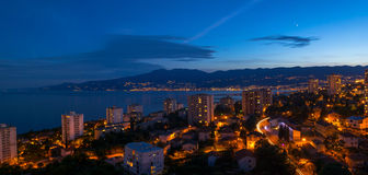 Rijeka at Evening. Rijeka, Croatia, with City lights, photographed at Summer evening hours from Apartment Windows Stock Images