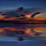 Rijeka sob nuvens após o por do sol Foto de Stock Royalty Free
