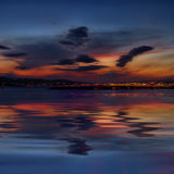 Rijeka under clouds after sunset. Town Rijeka after sunset with beautiful clouds and reflection in the sea Royalty Free Stock Photo
