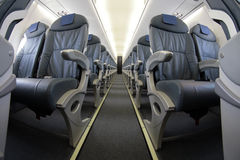 Rijen 012 van lijnvliegtuigzetels Stock Foto's