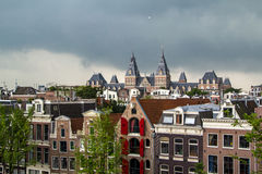 The Rijksmuseum in Amsterdam. Heavy clouds over the Rijksmuseum in Amsterdam in the Netherlands stock image