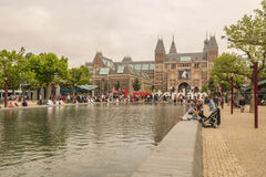 The Rijksmuseum of Amsterdam with a lot of tourists Royalty Free Stock Photo