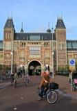 Rijksmuseum - National Museum, Amsterdam. Amsterdam, Netherland - October 16. People cycling near Rijksmuseum, national museum in Amsterdam, Netherland Royalty Free Stock Photo