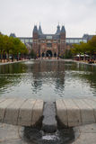 Rijksmuseum park and pool vertical view. Rijksmuseum main facade from the park vertical view in Amsterdam Holland Stock Image