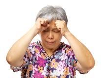 Rijpe Aziatische vrouwen ernstige hoofdpijn Stock Fotografie