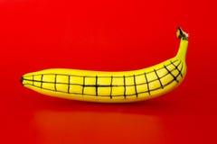 Rijpe banaan met een patroon aan zijn kant Stock Afbeeldingen