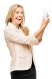 Rijpe de telefoon van het bedrijfsvrouwen videooverseinen mobiele het glimlachen isola Royalty-vrije Stock Afbeeldingen