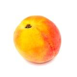 Rijpe die perzik op een wit wordt geïsoleerd Royalty-vrije Stock Foto