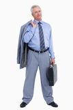 Rijpe kleinhandelaar die zich met koffer en jasje bevindt Stock Afbeeldingen