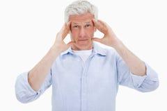 Rijpe mens die een hoofdpijn heeft Royalty-vrije Stock Fotografie