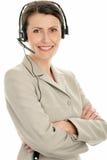 Rijpe onderneemster die hoofdtelefoon draagt Stock Afbeeldingen