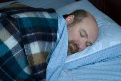 Rijpe in slaap mens stock foto