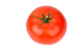 Rijpe tomaat die op wit wordt geïsoleerdt royalty-vrije stock foto's