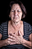 Rijpe vrouw die aan borstpijn lijdt Stock Afbeelding