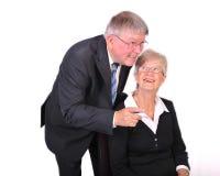 Rijpe Zakenman met het Bekijken van de Secretaresse omhoog hallo Stock Foto