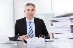 Rijpe zakenman op het werk Royalty-vrije Stock Afbeeldingen