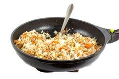 Rijst die pan vullen Royalty-vrije Stock Afbeeldingen
