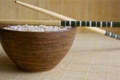 Rijst en Chinese eetstokjes Royalty-vrije Stock Foto's