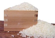 Rijst en houten container Stock Foto