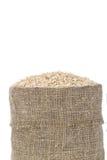Rijst in kleine jutezak Stock Foto's