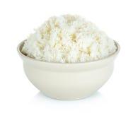 Rijst met kom op de witte achtergrond wordt geïsoleerd die Stock Afbeelding
