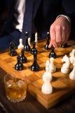 Rika affärsmän som spelar schack Royaltyfria Foton