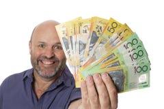 Rikedompengarkassa och stort leende royaltyfri foto