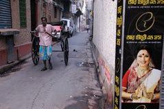 Rikscha-Abziehvorrichtung in Kolkata Stockfoto