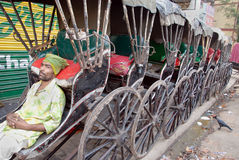 Rikschaabziehvorrichtungen in Kolkata Stockfotografie