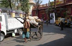 Rikschafahrer in Kolkata Stockfotos