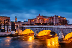 Riksdag Building and Norrbro Bridge in the Evening Royalty Free Stock Photography