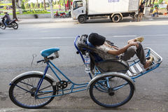 Riksha driver taking nap Royalty Free Stock Image