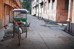 Rikshaw driver resting Stock Photography