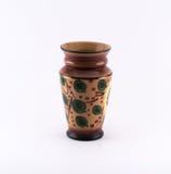 Rikt dekorerad brunt - grön vas arkivfoto