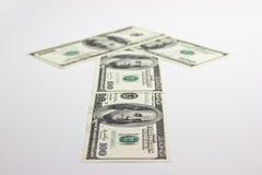 Riktning av pengar Arkivbild